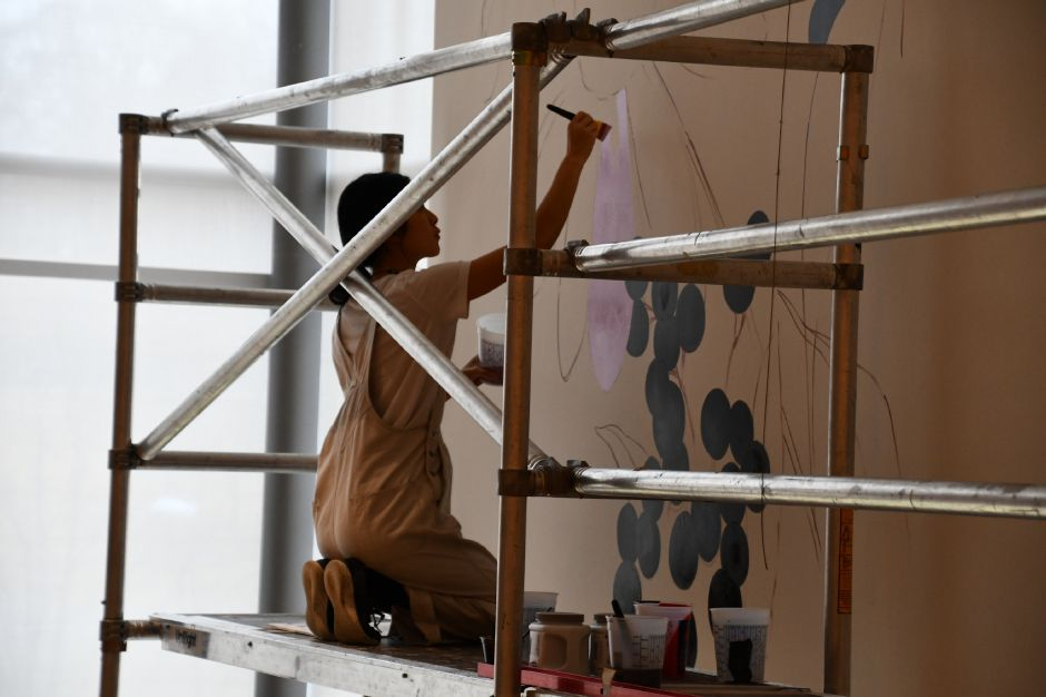 "Artist Louise Jones paints a the mural ""Winter Spring Summer Fall"" on the wall of New Britain Museum of American Art, 56 Lexington St., New Britain. 
