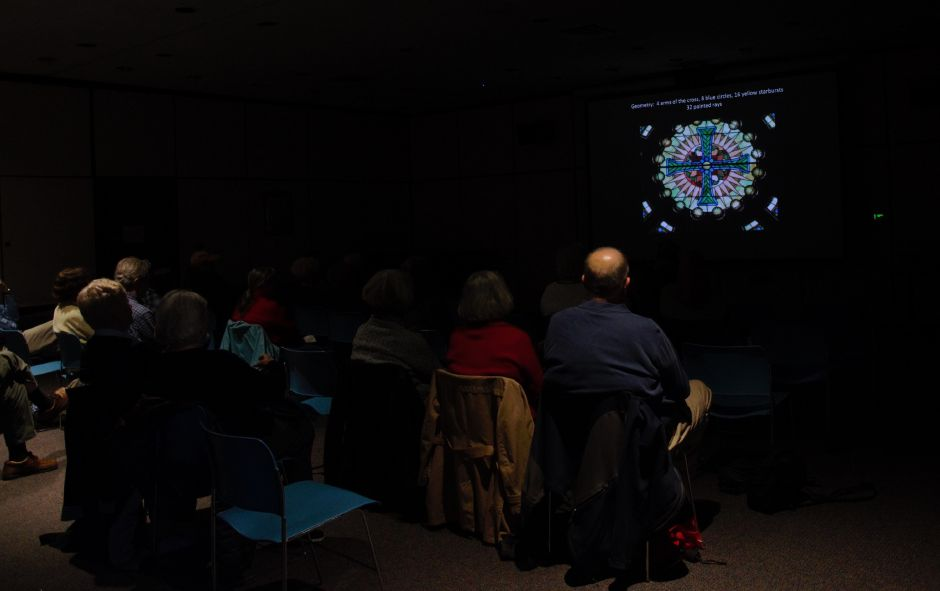 The audience looks at a photo of St. Rose Church during a talk about stained glass at the Meriden Public Library on  Tuesday, April 9, 2019. | Maxine Philavong, Special to the Record Journal.