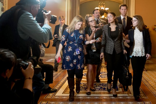 Rep. Alexandria Ocasio-Cortez, D-N.Y., third from right, speaks to reporters as she walks out of the Senate Chamber following two failed votes on ending the partial government shutdown on Capitol Hill in Washington, Thursday, Jan. 24, 2019. (AP Photo/Andrew Harnik)