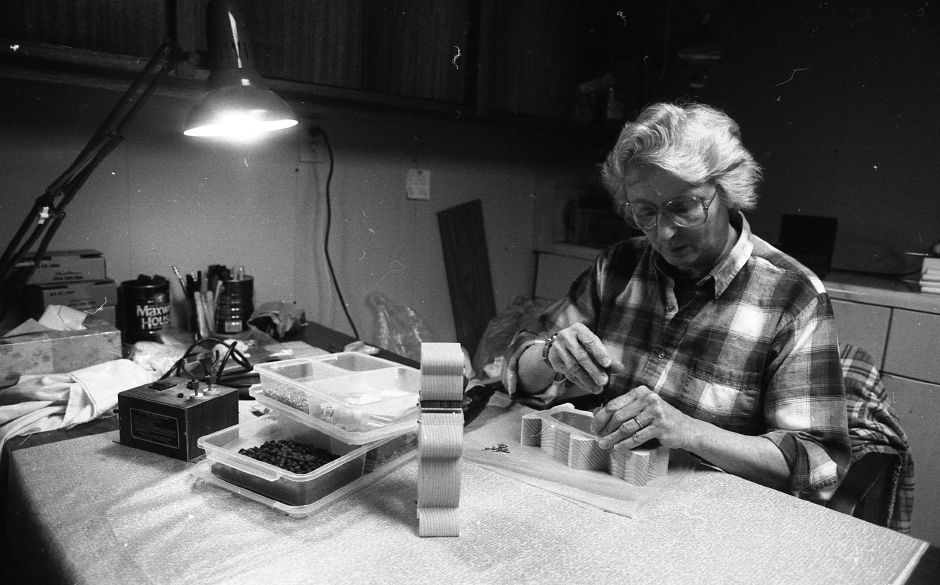 RJ file photo - Martha L. Becker works on one of the many wooden toys she and her husband make in their Wallingford home, April 1989.