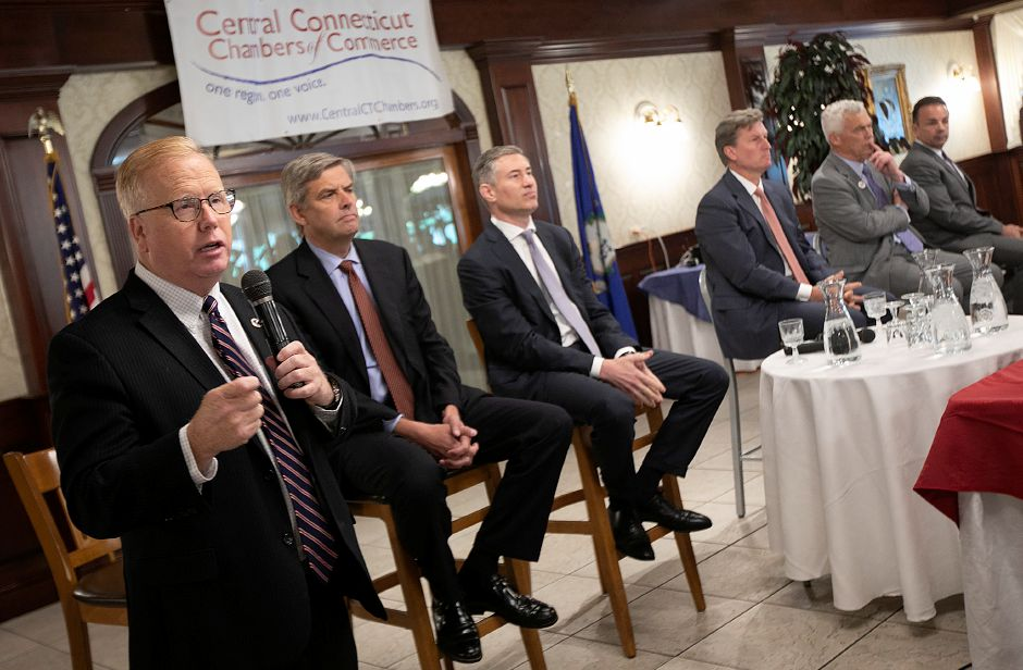 Republican Mark Boughton, left, speaks during the Central Connecticut Chambers of Commerce Gubernatorial Forum at the Aqua Turf Club in Southington, Thursday, August 9, 2018. Candidates, left to right, Republican Bob Stefanowski, Republican David Stemerman, Republican Steve Obsitnik, Independent Oz Griebel and Democrat Joe Ganim listen to Boughton