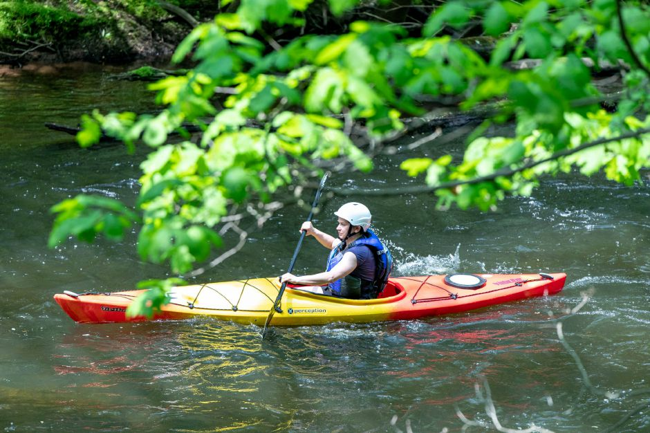 A paddler picks up speed in a straight section of the Quinnipiac Downriver Classic race on May 19, 2019. The yearly kayak and canoe race attracted 35 participants this year, going from the Meriden-Waterbury Turnpike to the Red Bridge on Oregon Road in Meriden. Devin Leith-Yessian/Record-Journal