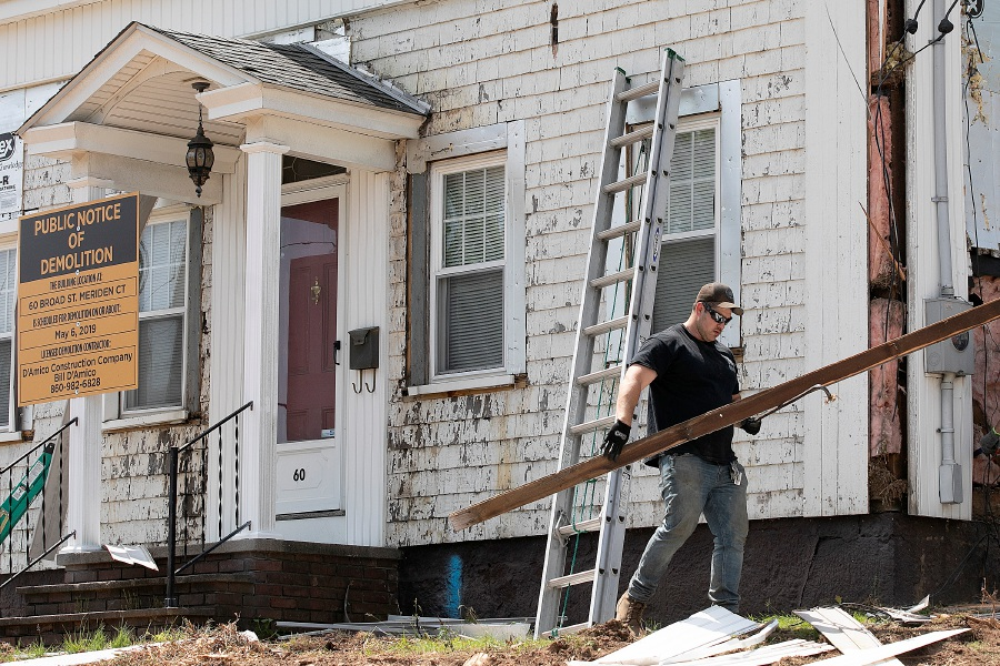 Crews continue demolition on a 19th-century home at 60 Broad St., Meriden, Wed., May 22, 2019. The demolition of two Broad Street homes began earlier this month to make way for what one contractor confirmed will be a Dollar General store. Dave Zajac, Record-Journal