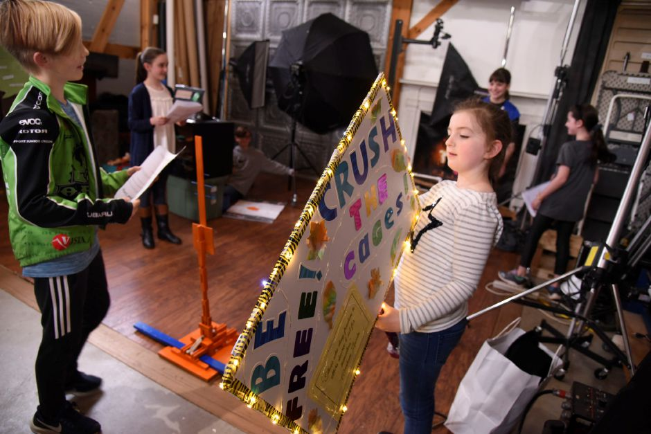 Third-grader Daphne Liss, of Durham, holds a light-up sign as part of her role in the Coginchaug Valley Education Foundation Odyssey of the Mind team, during their practice on April 30. | Bailey Wright, Town Times