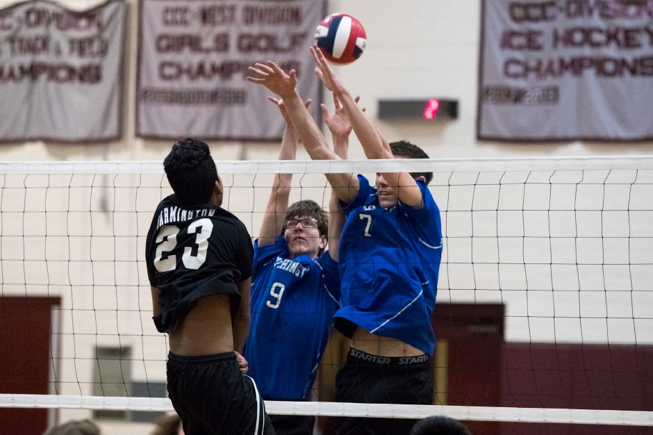 Tim Walsh (7), Brett Hunter (9) and the Southington boys volleyball team was a spotless 23-0 until running into defending champ Staples in the Class L semifinals on Tuesday night. The Wreckers swept the Blue Knights 3-0 in Oxford. | Justin Weekes / Special to the Record-Journal