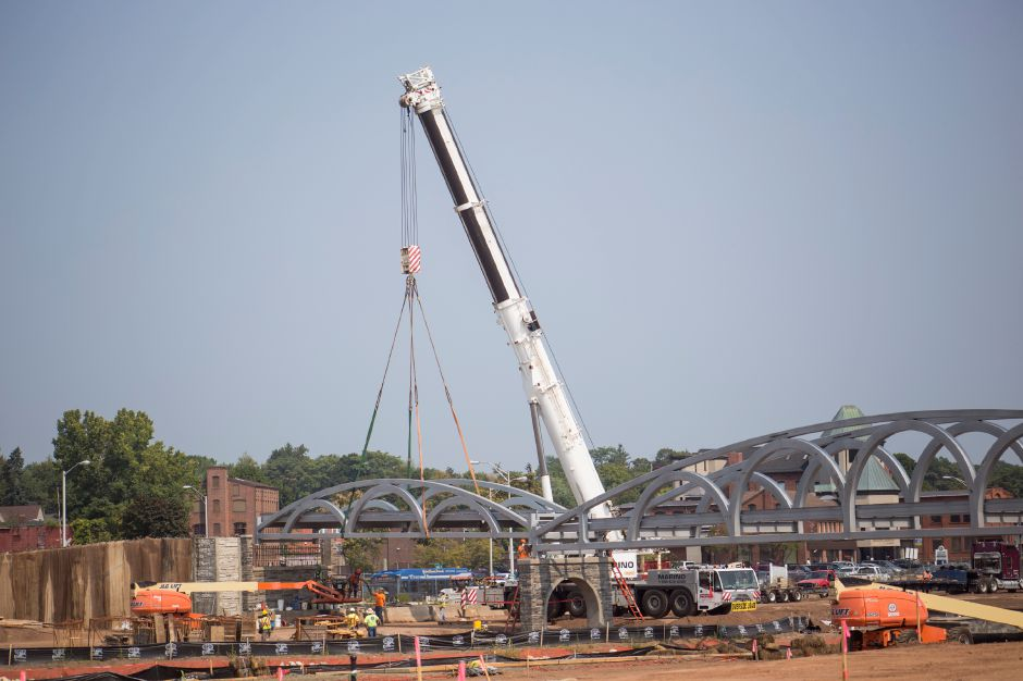Crews hoist the last frame for the pedestrian bridge into place at the Meriden Hub Thursday Sept. 3, 2015. | Richie Rathsack/Record-Journal