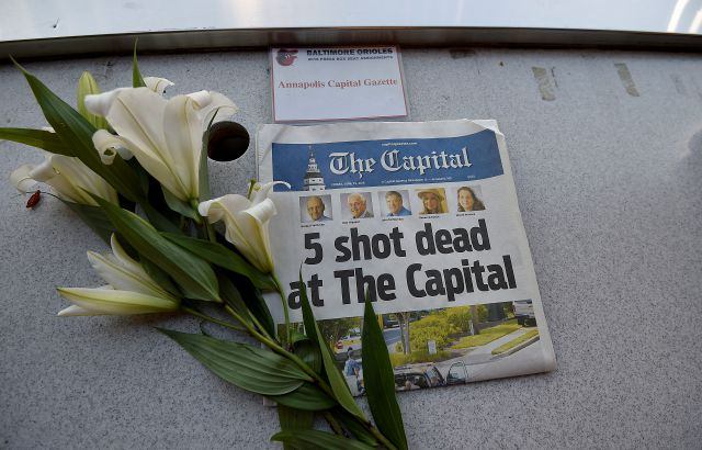 A memorial for Capital Gazette sports writer John McNamara is displayed at a seat in the press box before a baseball game between the Baltimore Orioles and the Los Angeles Angels, Friday, June 29, 2018, in Baltimore. McNamara is one of five victims in a  shooting in the newspaper