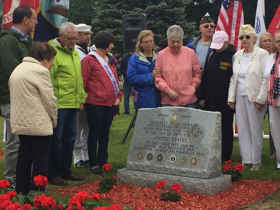 Gold Star mothers and family members gather around the new monument on Memorial Day in Plainville, Monday, May 29, 2017. |Ashley Kus, The Plainville Citizen