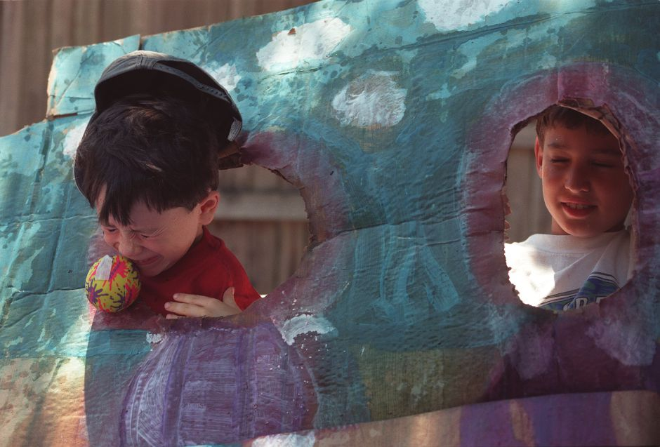 Wallingford YMCA nickel carnival with Matthias Carrgan, 7, left, and Frank Falcone, 9, right, getting hit with wet sponges JUly 23, 1999.