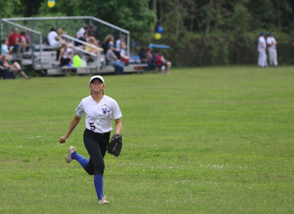 Wilcox Techs Tatiana Gonzalez tracks down a fly ball against Goodwin Tech in Meriden. May 20th, 2019 | Spencer Davis, Record Journal