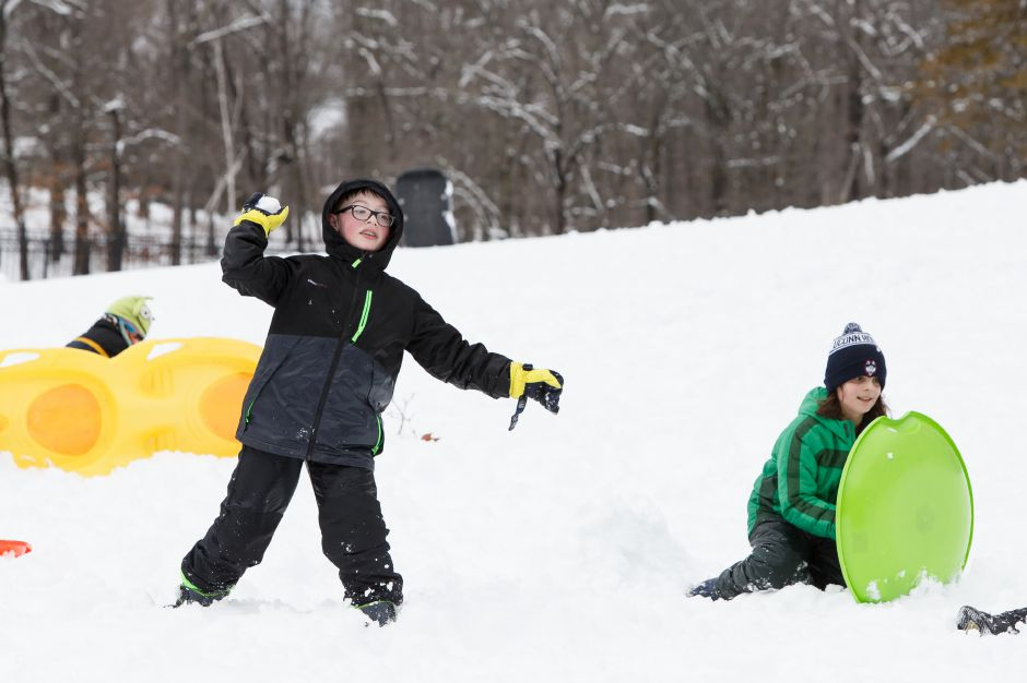 Noah Perry, 12, left, returns fire during a snowball fight in Hubbard Park  Thursday.