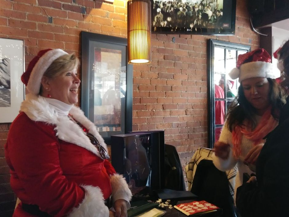 Michele Stocking announces the  winner at Gaetano's during SantaCon in Wallingford on Dec.  8, 2018.