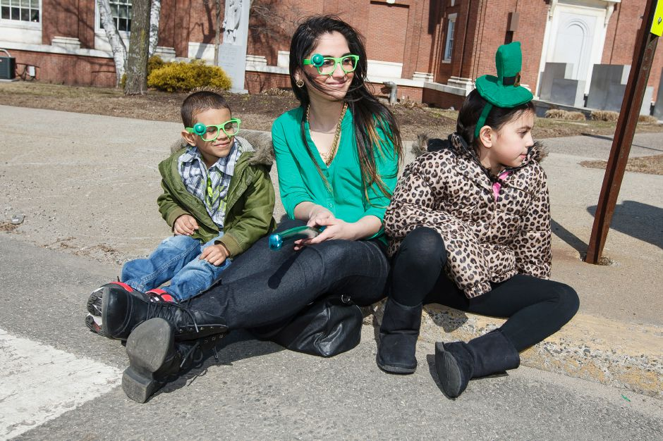 Felix Lugo 6, Amanda Nieves and Devannise Lugo 9 all of Meriden wait for the next float during the St. Patrick