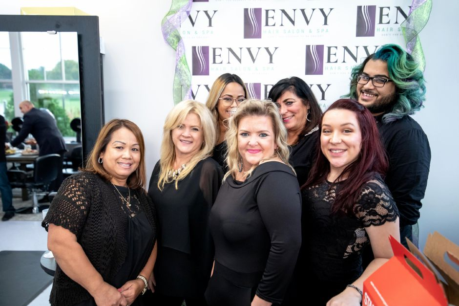 Nichole Vega, of Newington, held a ribbon cutting ceremony on Oct. 1 after moving Envy Salon to the Berlin side of the Turnpike. The salon