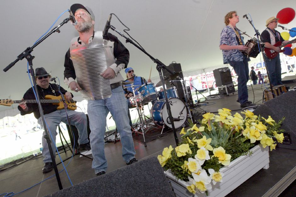 River City Slim & The Zydeco Hogs play their tunes under the Food Tent Stage during the 32nd Annual Daffodil Festival at Hubbard Park on Saturday, April 24, 2010. (Rob Beecher / Record-Journal)
