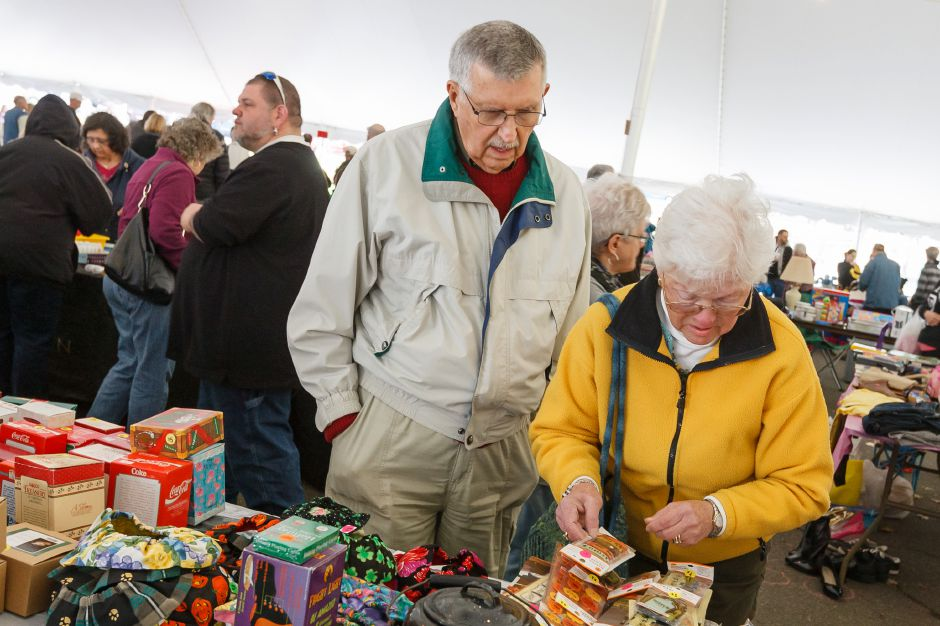 Warren and Paula Posser traveled from Fairfield to chesk out what was to offer Saturday during the Daffodil Tag Sale in Hubbard Park Meriden August,5 2013 | Justin Weekes / For the Record-Journal