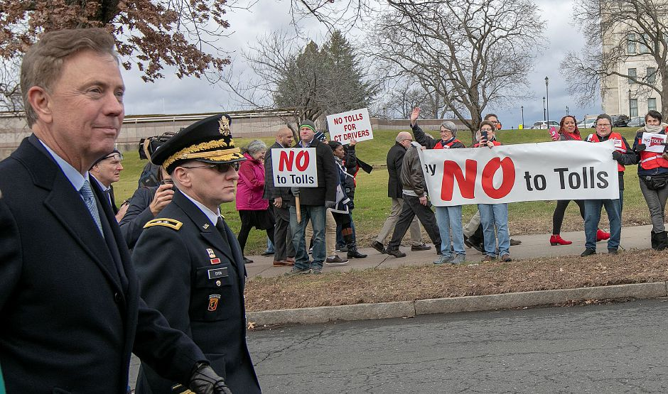 Gov. Ned Lamont walks by protestors in opposition to tolls during a parade following his inauguration ceremony Jan. 9, 2019. | Dave Zajac, Recocrd-Journal
