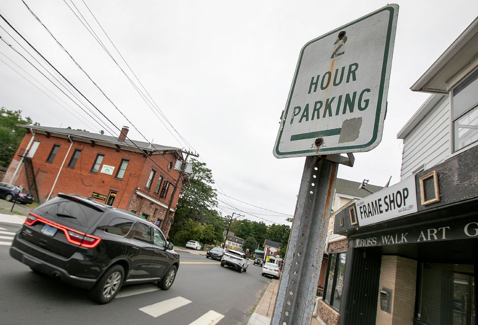 A 2-hour parking sign stands near businesses along West Main Street in downtown Plantsville on Thursday. A project that'll include wider sidewalks, narrower roads and aesthetic upgrades  took a step forward with the hiring of a design firm. Dave Zajac, Record-Journal