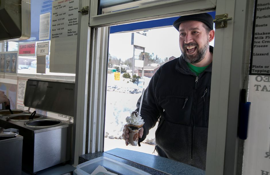 Steve Cicio, of Meriden is all smiles with a peanut butter parfait on opening day at Les