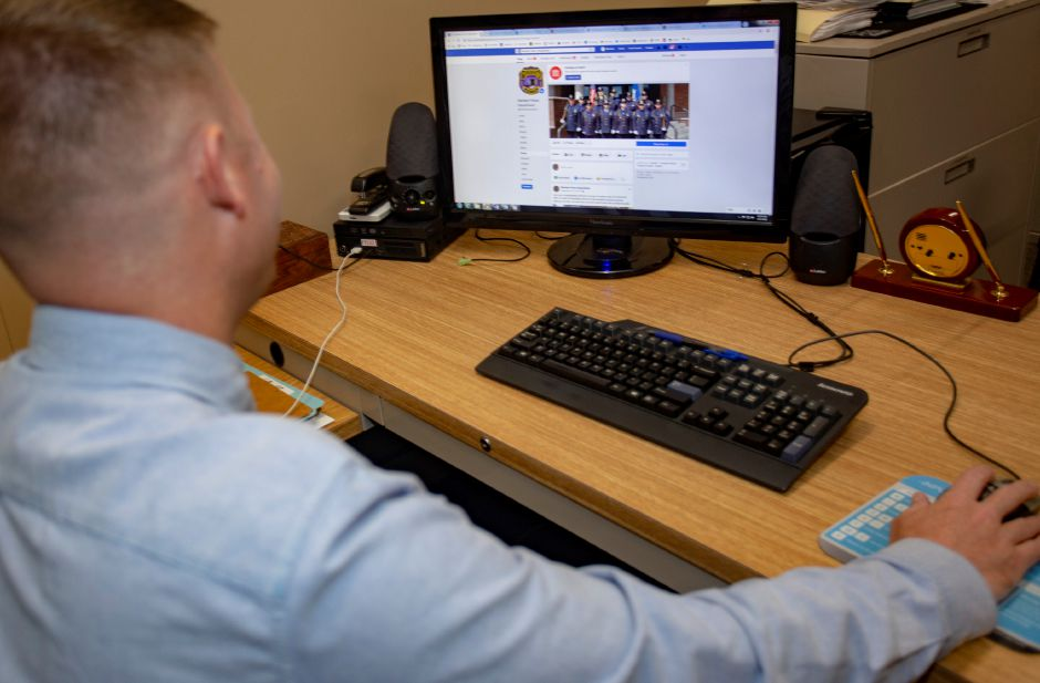 Meriden Police Sgt. Christopher Fry manages the department's Facebook page (Richie Rathsack | Record-Journal)