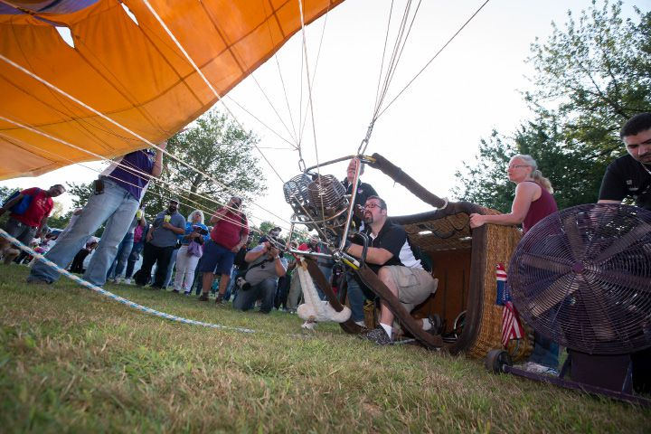 "Pilot Tony Wagoner of Bristol uses the burner to inflate ""Wild Ride"" hot air balloon Friday during the Plainville Fire Company 33rd Annual Hot Air Balloon Festival at Norton Park in Plainville Aug. 25, 2017 
