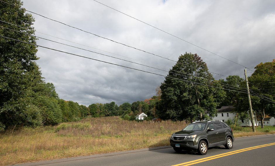 A motorist travels by a land parcel on South End Road in Southington, Wednesday, Oct. 3, 2018. Planning officials are considering regulation changes that would allow more houses in a subdivision in exchange for open space. Dave Zajac, Record-Journal