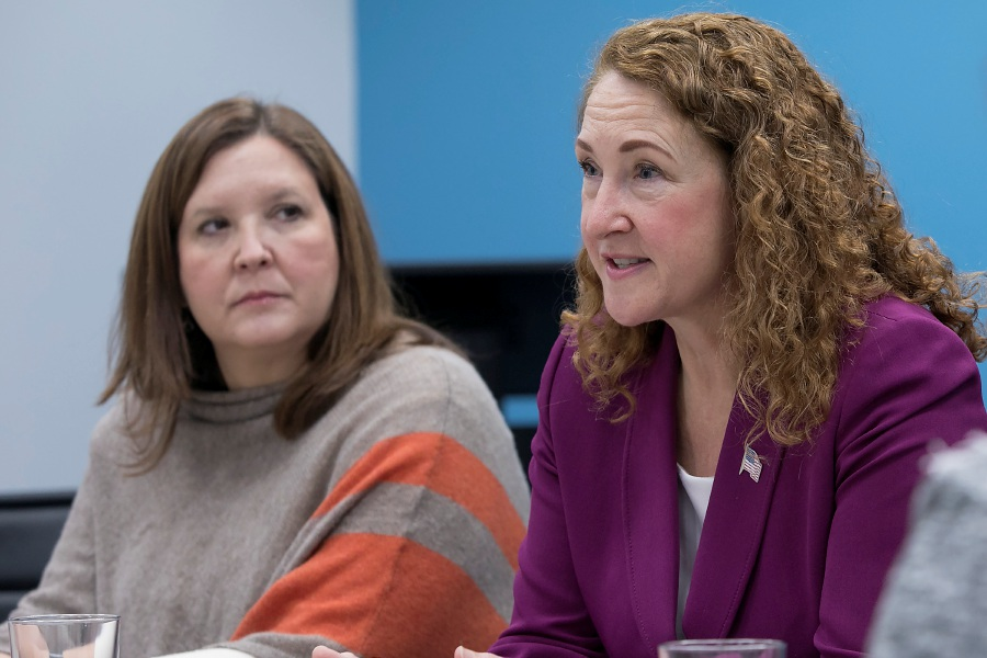 U.S. Rep. Elizabeth Esty, right, meets Monday in Cheshire  with officials from the Community Health Center Association of Connecticut  to share their concerns over the uncertainty of funding source. Mollie Melbourne, left, is chief operating officer of the association.