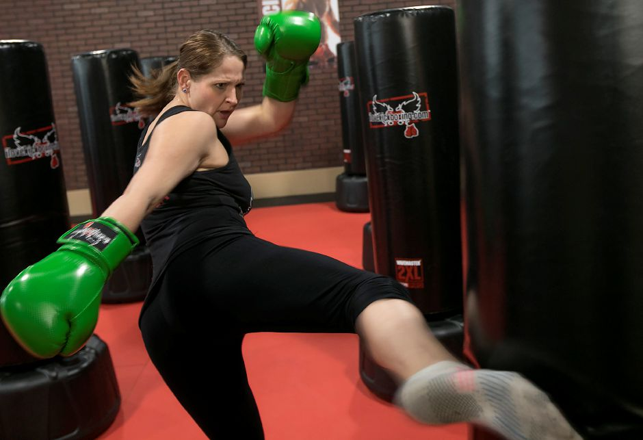 Danielle Trubia, manager/instructor, demonstrates a few kicks at iLoveKickboxing, 99 Executive Boulevard in Southington, Thursday, Feb. 15, 2018. Dave Zajac, Record-Journal
