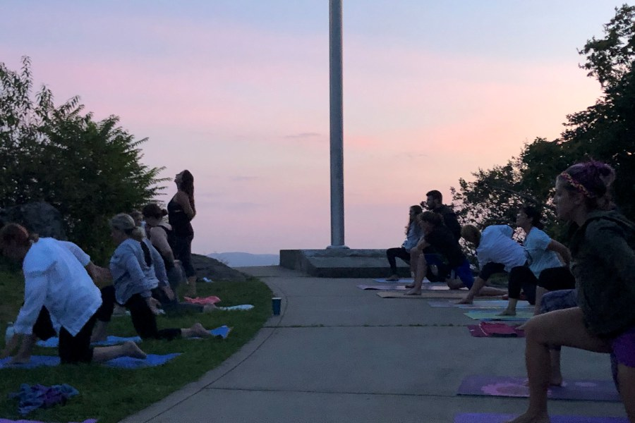 A moonlit yoga event at Castle Craig in Meriden. Kristen Dearborn, special to the Record-Journal