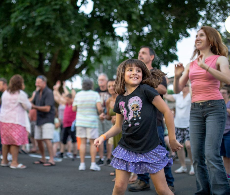 A girl dances during the Long Island Sound Band