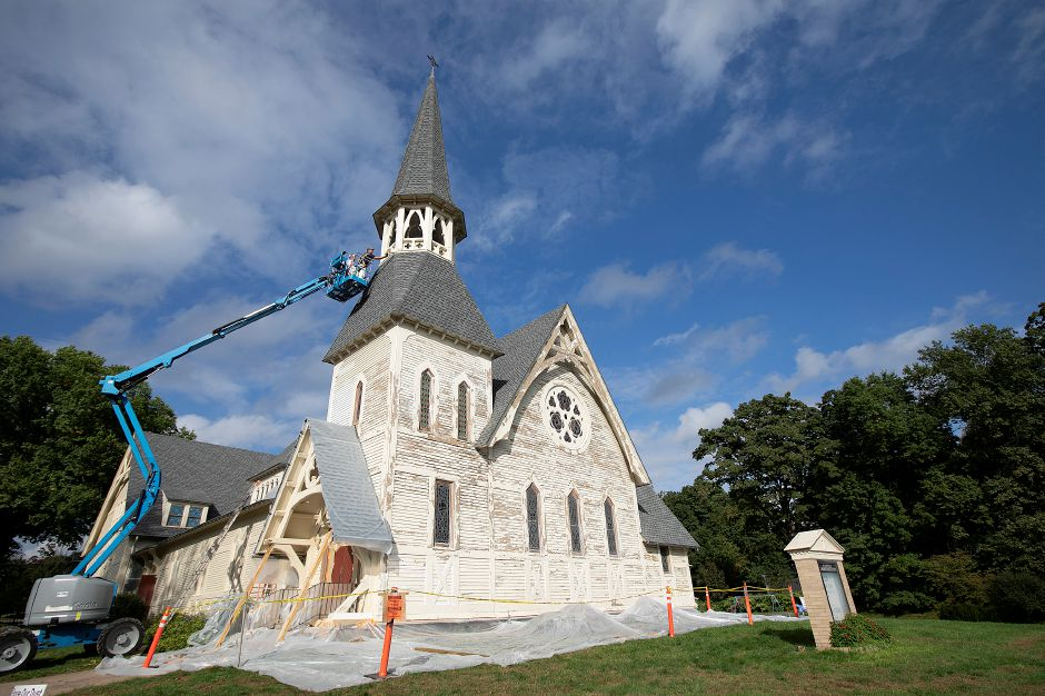 Workers from Ronald J. Hepp Restoration and Northeast Painting and Decorating caulk the steeple of Plantsville Congregational Church as renovations continue on the 1866 church, Tuesday, Oct. 9, 2018. Dave Zajac, Record-Journal