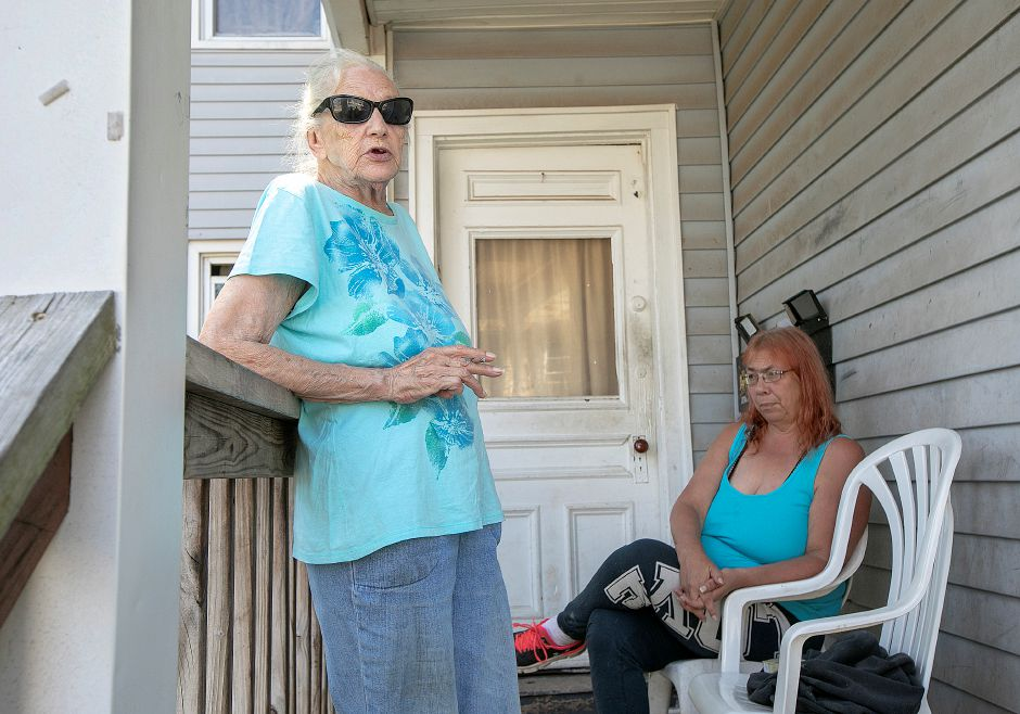 Rita Brovender, of Meriden, left, talks next to friend Margie Marks at Marks