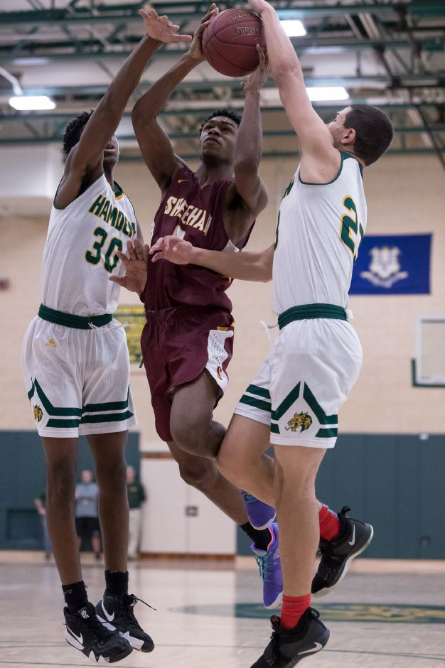 Sheehan's Kristopher Jackson tries to split Hamden's  defense on a drive Thursday during the opening round of the SCC boys basketball tournament at Hamden High School. Hamden won 69-63.Photos by Justin Weekes, special to the Record-Journal