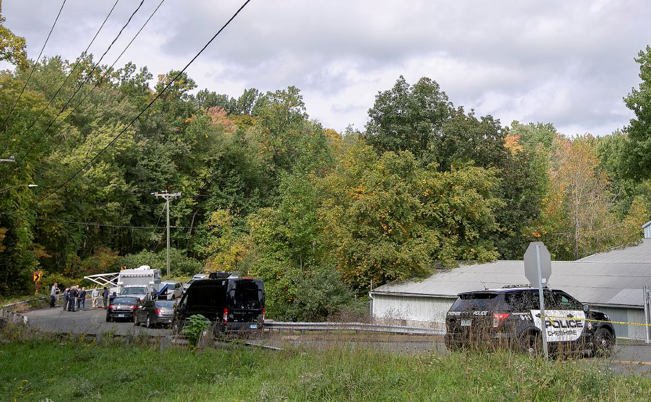 Local and state police investigate after a missing person was found dead near the intersection of Mixville and Marion roads in Cheshire, Wednesday, Oct. 4, 2018. | Dave Zajac, Record-Journal