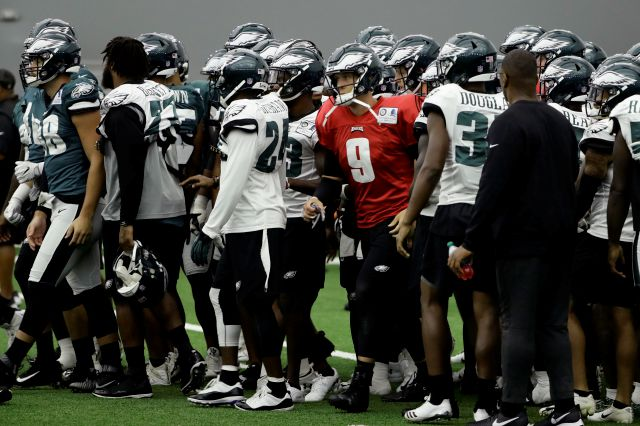 Philadelphia Eagles quarterback Nick Foles (9) and his teammates move to their next drill during NFL football training camp in Philadelphia, Monday, Aug. 13, 2018. (AP Photo/Matt Rourke)
