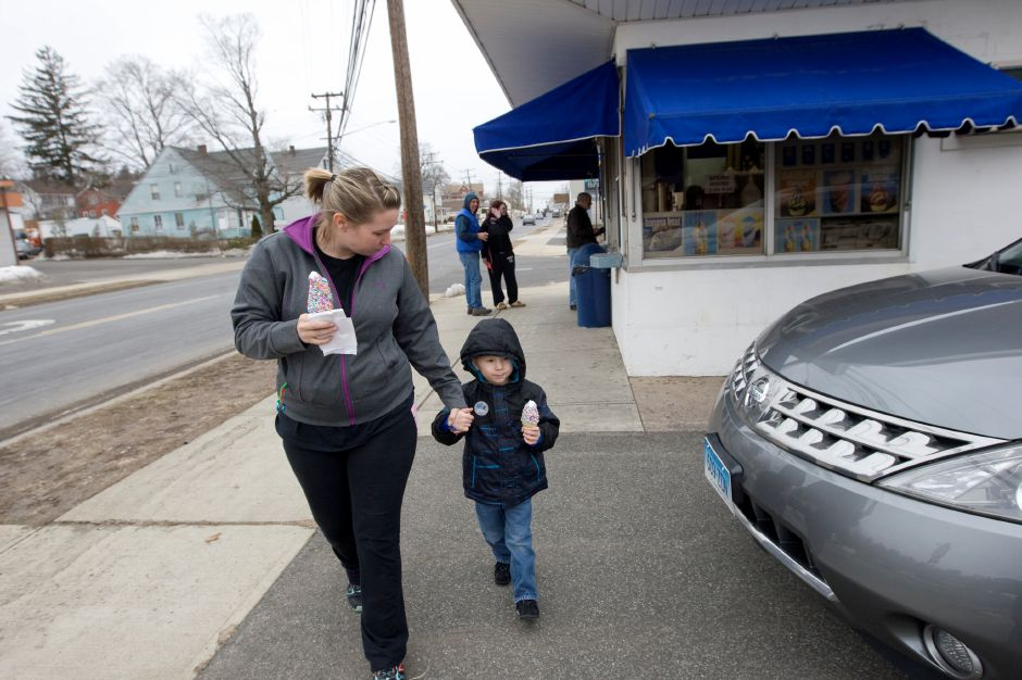 Julius Blinn, 3, of Meriden, and mother, Alicia Sands, enjoy the first cones of the year- Blue Goo Flavor Burst cones with rainbow sprinkles served at Les