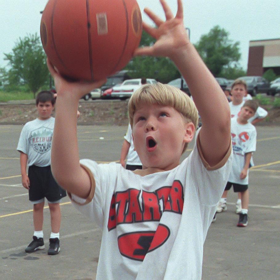 Steven Drozd, 9, shoots for the hoop during a rebound drill the The Hoop House Basketball Camp at The Wallingford Park and Recreation Center July 1999.