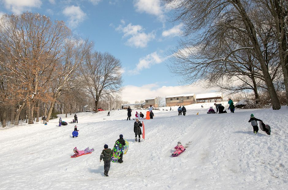 Children and adults enjoy a day of sliding at Panthorn Park in Southington, Mon., Mar. 4, 2019. An overnight storm left about 10 inches of snow in the area. Dave Zajac, Record-Journal