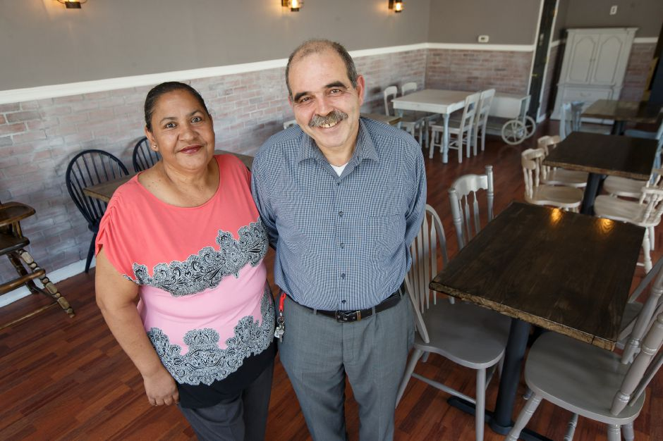 Owners Sam Sharif and Sonia Gomez stand in the dinning area of the restaurant Wednesday at Arles and Boggs Vegan Eatery in Wallingford October 10, 2018 | Justin Weekes / Special to the Record-Journal