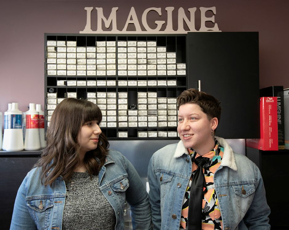 Barbers Cass Quinn, left, and Nikki Castillo, talk at Imagine Hair Studio in Wallingford. Quinn and Castillo have organized a cut-a-thon to benefit a regional LGBT advocacy group and draw attention to discrimination in the barbering industry.  Dave Zajac, Record-Journal
