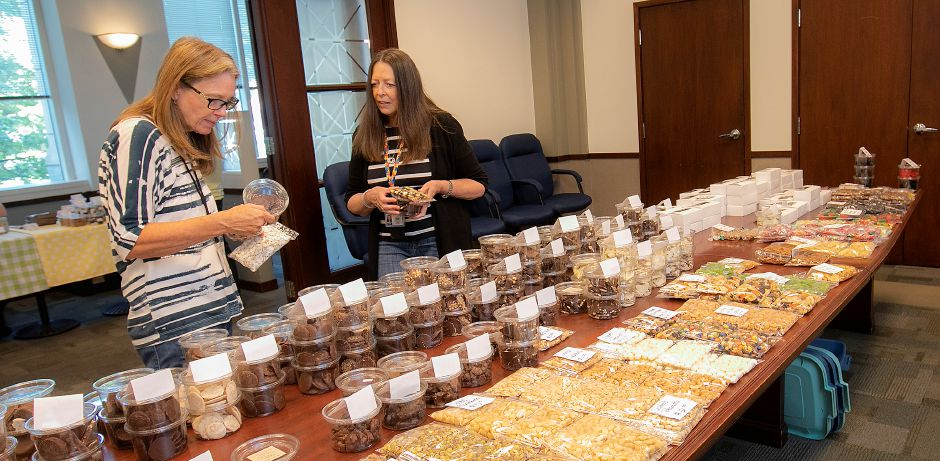 State employees Sallie Kolreg, left, and Cathy Calway, look over chocolates for sale by chocolatier Rosie Okinsky at 55 Farmington Ave. in Hartford, Fri., Sept. 13, 2019. Okinsky is moving her entire operation from New Jersey to Connecticut and hopes to open in Factory Square on Center Street in Southington in about two months. Dave Zajac, Record-Journal