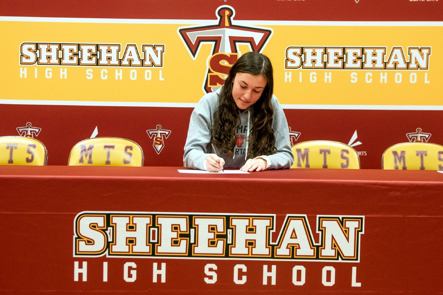 Sheehan's Olivia Dubuc signs a letter of intent to play soccer at the Division II University of Tampa during a ceremony at Sheehan High School on Wednesday, Dec. 4, 2019. Aaron Flaum, Record-Journal