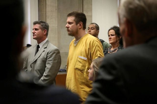 Former Chicago police Officer Jason Van Dyke and his attorney Daniel Herbert listen during Van Dyke