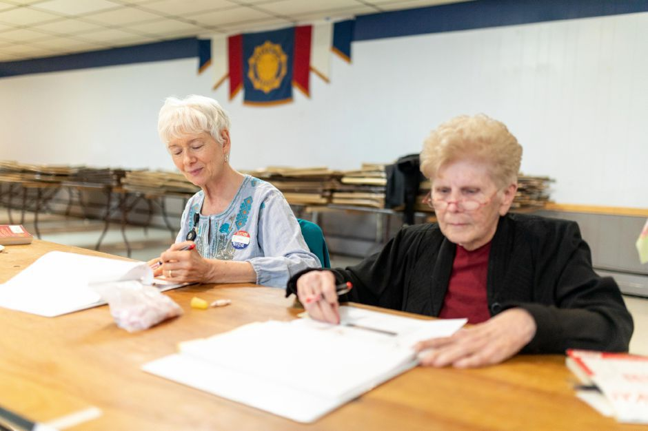 Poll workers Pat Baxa, left, and Nita Chojnicki staff the polling location at the Berlin American Legion during the April 30 budget referendum. Voters narrowly rejected the school budget as too low, while voting against the municipal budget as too high. | Devin Leith-Yessian, The Citizen