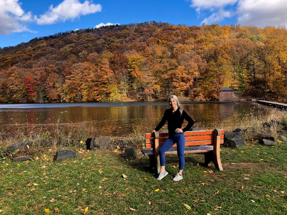 Kristen Dearborn stands by the reservoir at Giuffrida Park in Meriden before making the trek up to Chauncey Peak to take in some fall foliage Nov. 4, 2018. | Kristen Dearborn, Special to the Record-Journal