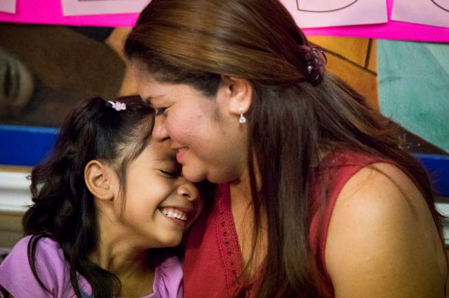 FILE - In this July 13, 2018, file photo, Allison, 6, and her mother Cindy Madrid share a moment during a news conference in Houston, where the mother and daughter spoke about the month and one day they were separated under the President Donald Trump administration immigration policy. The Trump administration is due back in court Monday, July 16, 2018, to discuss a plan reunify more than 2,500 children who were separated at the border from their parents. (Marie D. De Jes