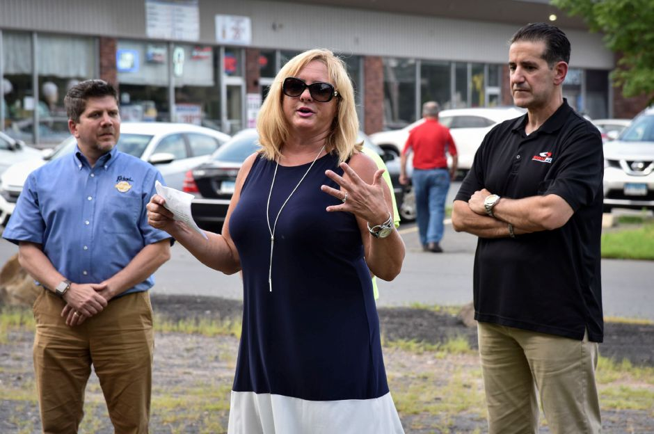 Southington town councilor and drive-in committee member, Dawn Miceli, speaks at a ribbon cutting for the Southington Drive-In