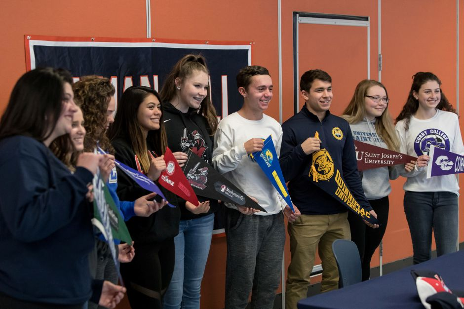 Lyman Hall held a group signing ceremony on Tuesday afternoon as these nine student-athletes announced their college commitments. They are, from left to right, Emily Kesilewski, Julia Blanchard, Morgan Tuscano, Sydney Nilsen, Theresa Lynch, Anthony Cretella Tyler Stowik, Nicole Albert and Ryleigh Shortell. | Justin Weekes / Special to the Record-Journal
