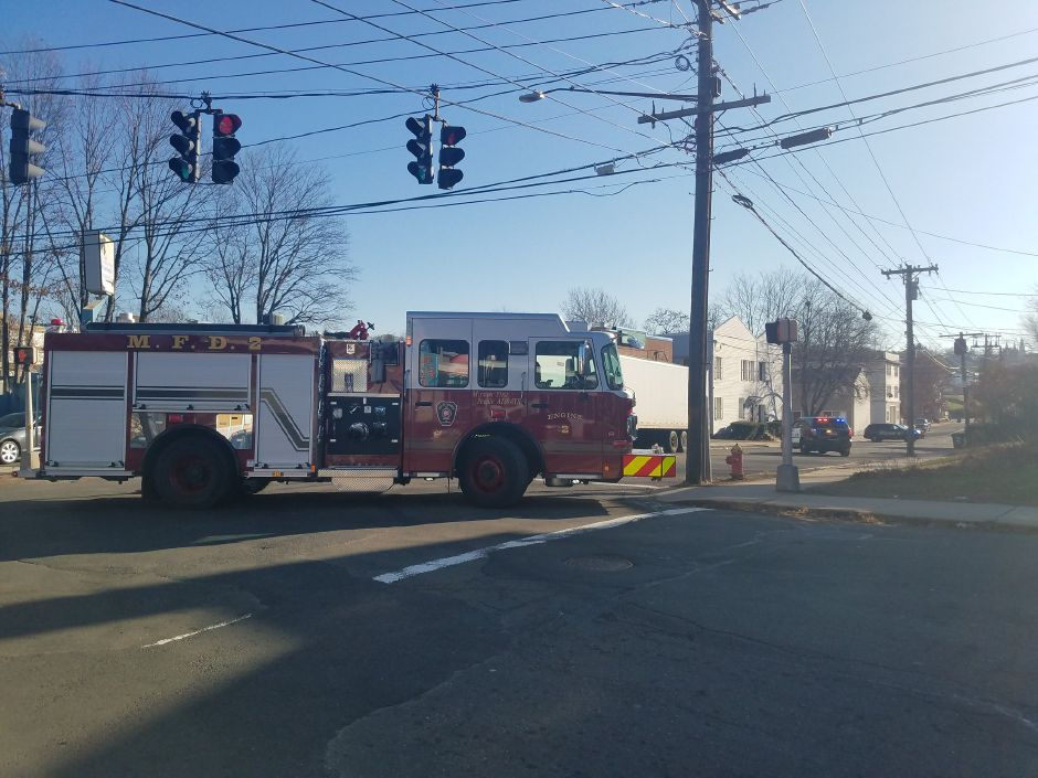 A section of Center Street was briefly closed Monday after a man was struck by a car. | Lauren Sellew, Record-Journal