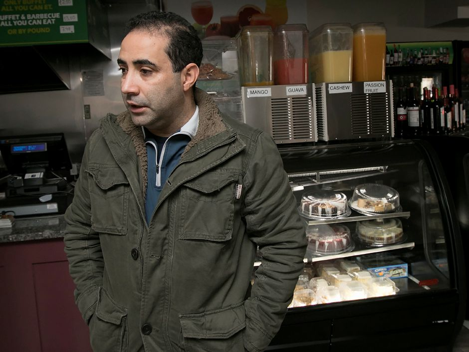Nilton Coelho, owner of Banana Brazil, talks about repairs needed at his restaurant on Hanover Street in Meriden. A fire shut down the business Monday morning. Photos by Dave Zajac, Record-Journal